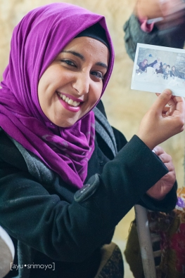 Jordanian Woman showing off her polaroid photo