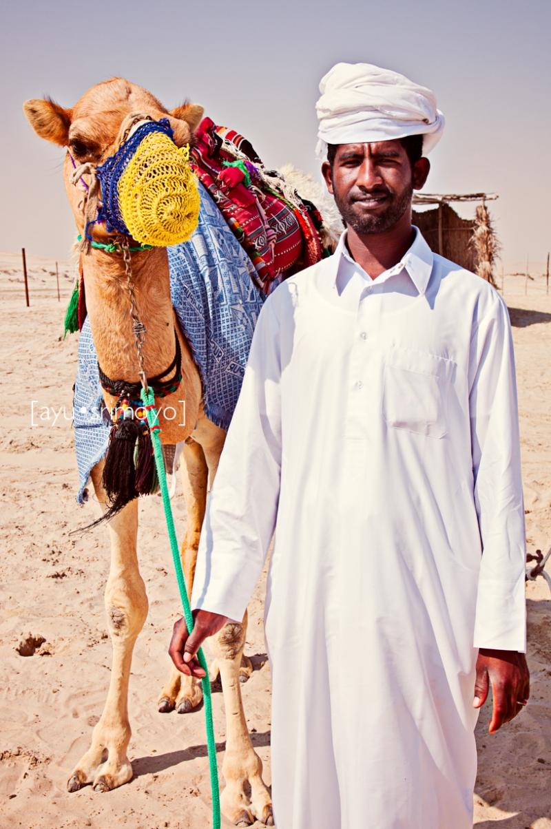 man and his camel, Qatar
